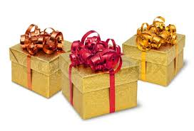boxes with bows three golden present gift boxes with silky bows and ribbons