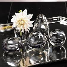 Accessorize Your End Table With Silver Vases And Votives by Modern