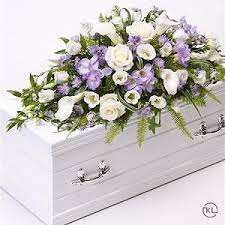 flower for funeral children s casket spray blue and lilac funeral flowers london