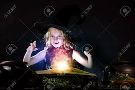 halloween photo book little halloween witch reading conjure from magic book stock photo