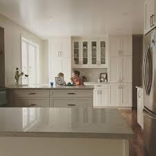 white shaker cabinets caesarstone bianco drift counters quadlevel