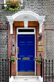 Blue House With Red Door 21 Cool Blue Front Doors For Residential Homes Brick Molding