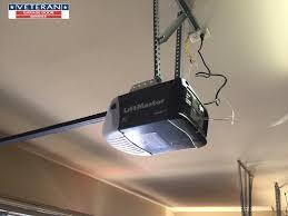 garage door opener track locating a ceiling stud inside a garage for opener instal