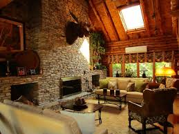rustic living room with metal fireplace u0026 cathedral ceiling in