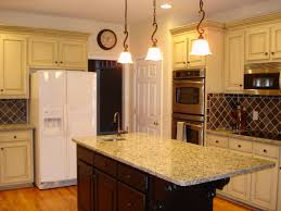 white wooden kitchen cabinet and brown wooden kitchen island with