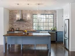 black and blue kitchen cabinets with brick backsplash 8815