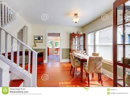 empty beige room with hardwood floor in old empty house stock