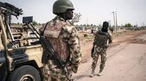 Soldier With Flag Army Claims Recovery Of Shekau U0027s Qur U0027an Flag In Sambisa Forest