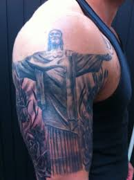 black ink christ the redeemer tattoo on man right shoulder