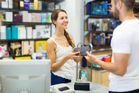 client at shop paying at cash register desk stock image image