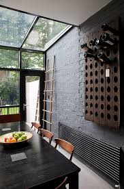 x wine rack over fridge dining room contemporary with gray wall