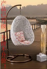 hanging rattan chair modern glass coffee table display shelves