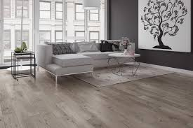 floor engineered wood flooring with white sofa and wall decor