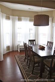 Curtains For Dining Room Windows by Make Your Picture Windows Look Huge By Hanging Bamboo Blinds And