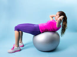 Sitting On A Medicine Ball At Desk These Are The Top Ab Exercises