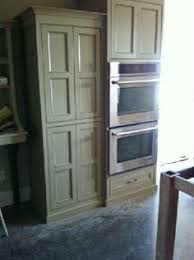 painted flat panels in elephant tusk benjamin moore cabinets by