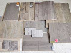 premier by armstrong 12mm weathered brown wood laminate flooring