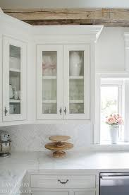 glass cabinets in white kitchen how to style glass kitchen cabinets sanctuary home decor