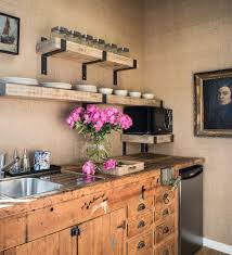 50 trendy eclectic kitchens that serve up personalized style walls covered in burlap and vintage kitchen cabinets shape the lovely kitchen design antonio