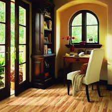 dining room pergo flooring with white baseboard and fireplace design