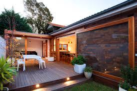 decorating backyard retreat with brick exterior and deck plus