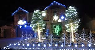 family decorates home with over 25k christmas lights flashing to