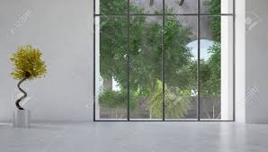 large floor to ceiling glass window in a white wall overlooking