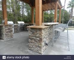 Building Stone Patio by Patio Furniture With Umbrellas On Stone Patio Near Upscale Condo