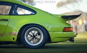 stanced porsche 911 admiring an icon the 1974 porsche 3 0 rs stanceworks