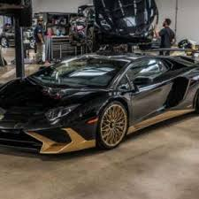 black and gold lamborghini this black and gold lamborghini aventador sv coupe is one of the