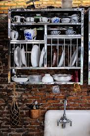 how to hang kitchen cabinets on brick wall vintage stainless plate rack kitchen cabinet with white