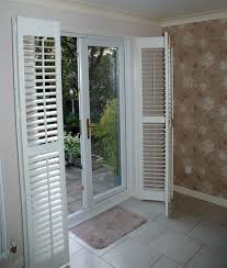 Sliding Shutters For Patio Doors Patio Door Shutters These Plantation Shutters Are Of The Bi Fold