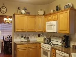 decorating ideas for the top of kitchen cabinets pictures ways to decorate above kitchen cabinets all about house design how