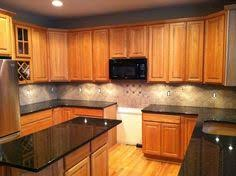 Black Countertop Kitchen by Honey Oak Kitchen Cabinets With Black Countertops Pearl Or