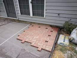 How To Install Pavers For A Patio Install A Paver Patio On Slope Building A Patio On A Slope Home