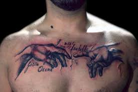words tattoos on chest with cross in 2017 photo