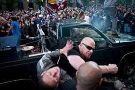 badass shot of a guy protecting his truck during the 2011
