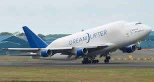 the boeing 747 dreamlifter taking off it is used exclusively for