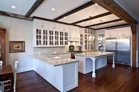 shaped kitchen island made of cedar tree designs pinterest white kitchen with beamed ceiling traditional kitchen