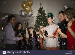 friends celebrating new years eve party at home stock photo