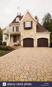 luxurious brown beige stone cottage style residential home with
