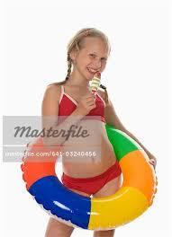 preteen girl modeling girl 10 11 wearing bikini holding ice cream smiling portrait
