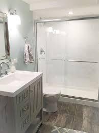 bathroom wood ceiling ideas exposed grey brick wall white marble floor tile exposed wood