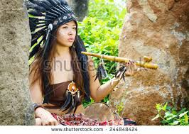 native american indians traditional dress stands stock photo