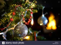 disco mirror ball decorations hanging from a christmas tree in