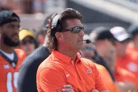 oklahoma state fans so mad about tcu they want mike gundy haircut