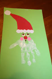 table of four homemade hand print christmas cards crafts