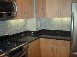 kitchen brown wooden kitchen cabinet with cream glass mosaic