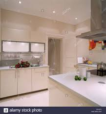 kitchen island extractor fan a modern white kitchen with a central island unit stainless steel