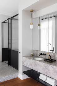 design house bath hardware bathroom materials marble terrazzo black hardware and brass via